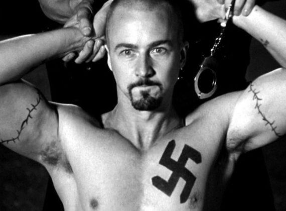 ทรงผม skinhead ครั้นหนึ่งในการเป็นสัญลักษณ์ของความรุนแรงและการเยียดเชื้อชาติ